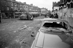 Local people survey the wreckage in Railton rd. In the early stages of the riot members of the public were surprisingly safe and wandered unhindered in areas the police couldn't get to.